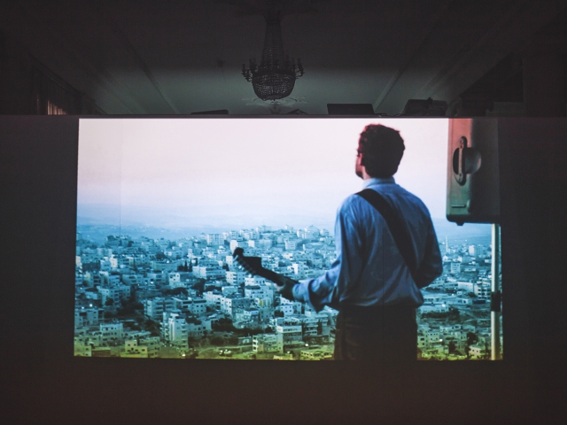 Daniel Kiczales, The Messenger, video, 2011.   /De/Constructing Borders, installation view.. Photo: Vlad Lemm