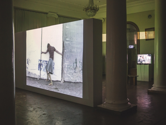 Rona Yefman, Pippi LongStockings, the strongest girl in the world, in Abu Dis, video, 2005-2006.  /De/Constructing Borders, instralation view. Photo: Vlad Lemm